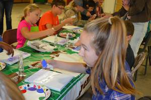 4-H visual arts project, youth working on water color paintings.