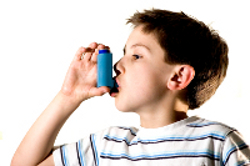 Photo of boy with asthma inhaler